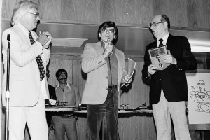 Ray Bradbury presents Julie Schwartz with Inkpot Award during the 1981 Comic-Con banquet, with Harlan Ellison.