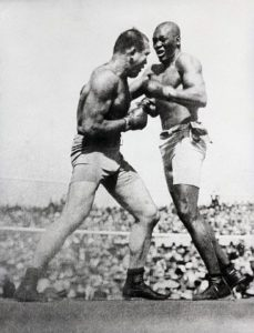 Action shot of Jack Johnson fighting Jim Jeffries at Reno in 1910.